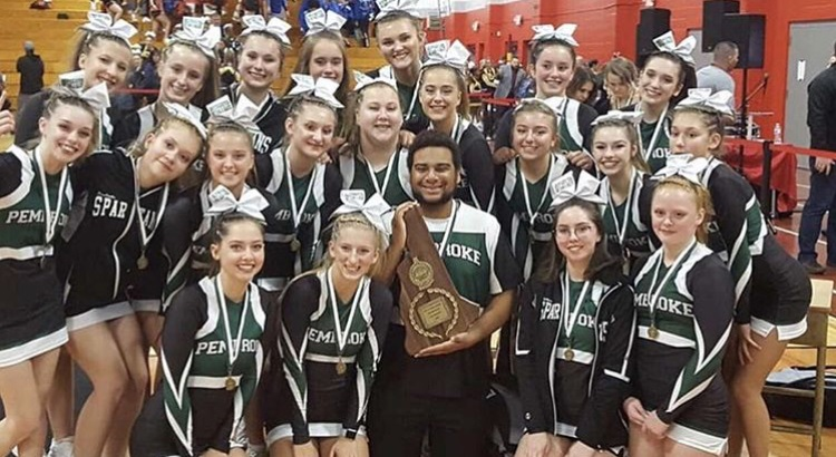 PAs spirit team poses after securing the Division II State Championship at Pinkerton Academy in Derry.