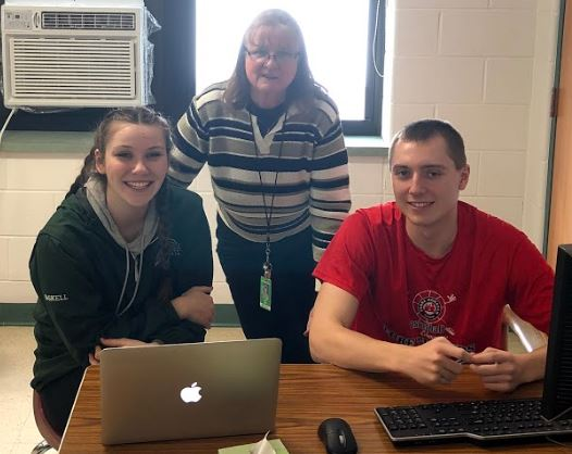 Mrs. Allen (center) works with seniors Madison Gaskell (left) and Sean Menard.