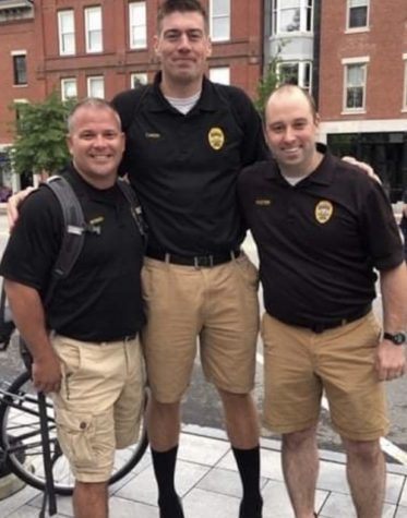Officer Webber (left) stands with fellow PPD officers.