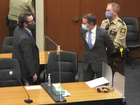 In this image from video, former Minneapolis police Officer Derek Chauvin, center, is taken into custody as his attorney, Eric Nelson, left, looks on, after the verdicts were read at Chauvin